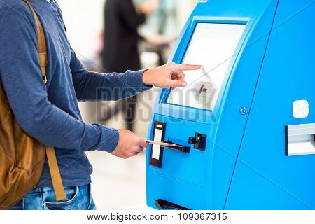 Closeup display at self-service transfer machine, doing check-in for flight or buying airplane ticke