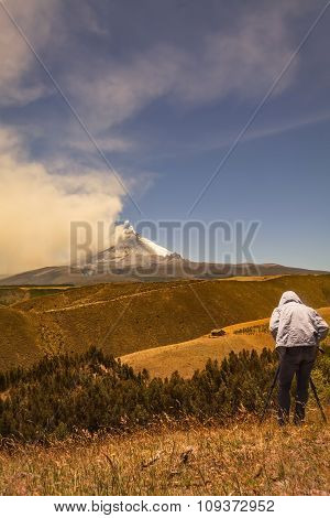 Professional man photographer posing Cotopaxi volcano