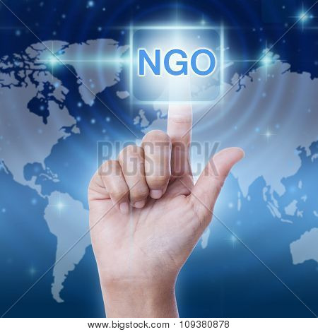 hand pressing NGO (Non-Governmental Organization) sign on virtual screen. business concept