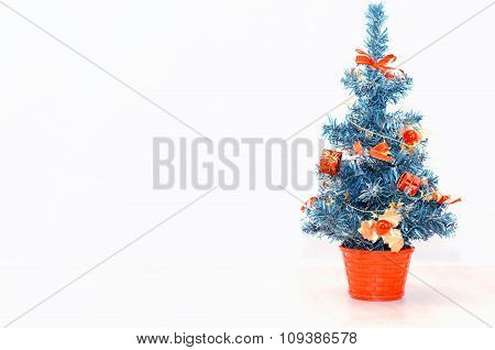 Decorated Christmas Tree On A Light Background