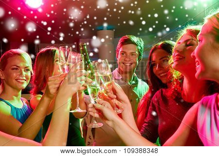 new year party, holidays, celebration, nightlife and people concept - smiling friends clinking glasses of non-alcoholic champagne in club and snow effect poster
