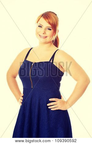 Happy plus size woman posing in skirt