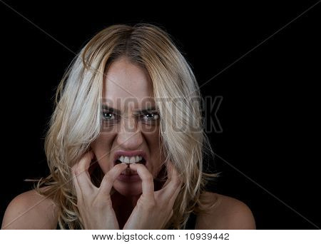 Frustrated woman on black background.