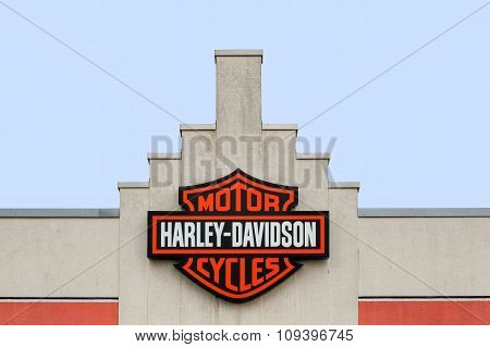 Bremen, Germany - October 23, 2015: Harley-Davidson logo on a store. Harley-Davidson is an American motorcycle manufacturer, founded in Milwaukee, Wisconsin in 1903.