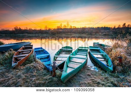 Lake, River and old wooden rowing fishing boat at beautiful sunr