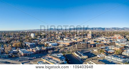 Fort Collins downtown aerial panorama,  fall  scenery od Colorado with Front Range of Rocky Mountains in background