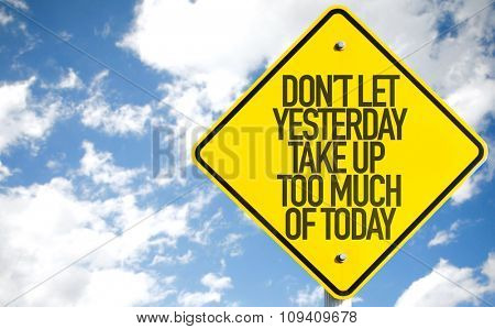 Don't Let Yesterday Take Up Too Much of Today sign with sky background