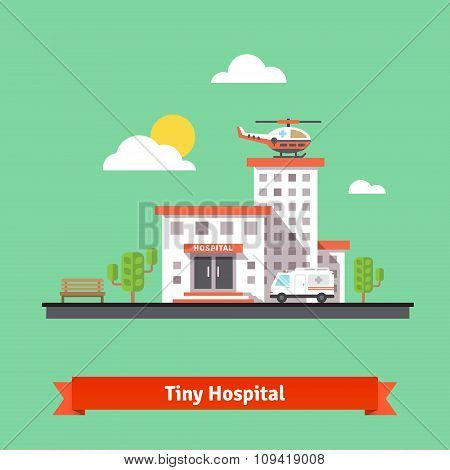 Clinic building with ambulance helicopter and car