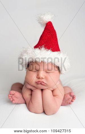 Cute Newborn Baby Girl Wearing A Santa Hat