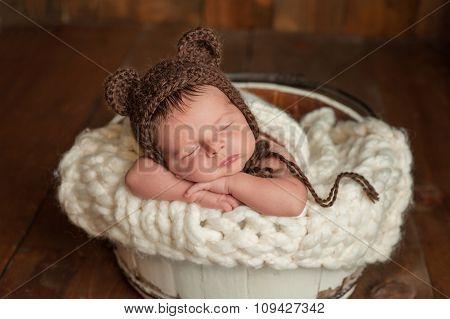Newborn Baby Boy Wearing A Bear Bonnet