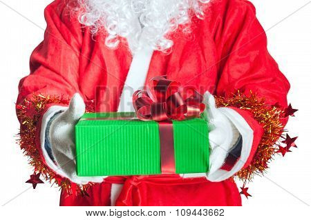 Santa Claus holding a gift isolated