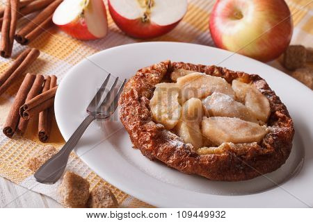 Dutch Baby Pancake With Apples On The Table Close-up Horizontal