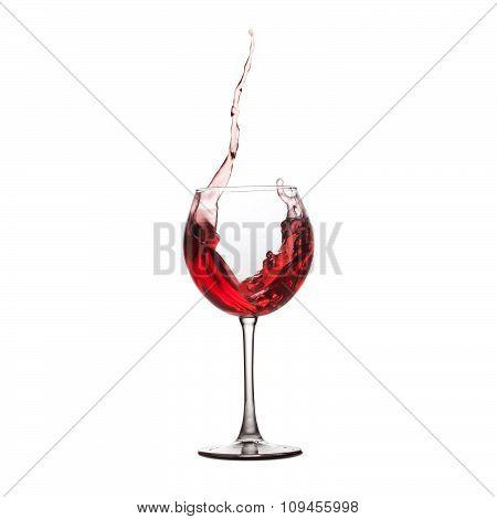 Red wine splash. splashing in crystal wineglass. white background.