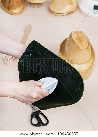 Hatter Gluing A Felt Hood For Shaping On Hat-block