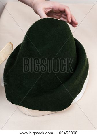 Hatter Fixes A Felt Hood On Hat-block For Shaping