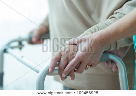 Close-up Of Woman Using Walker