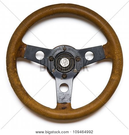 an old steering wheel on white - with clipping path. sign in the centrer is hand-craved and is not trademark