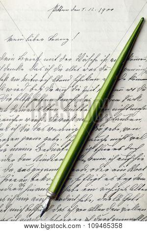 calligraphy pen on a vintage letter