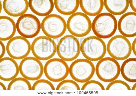 a frameful of latex condoms lit through