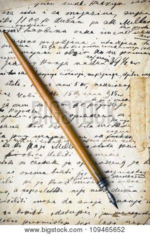 a vintage pen on a handwritten grunge paper