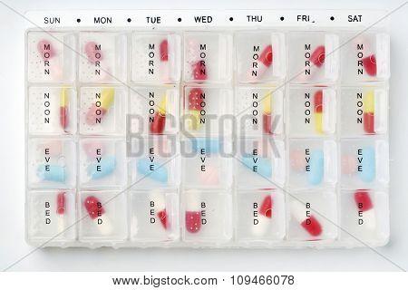 a week pill organizer on white