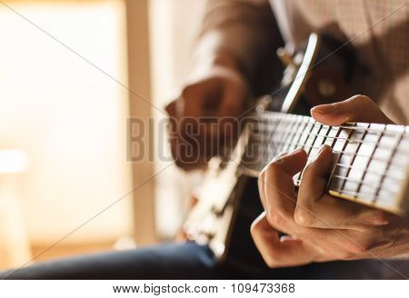Practicing in playing guitar.