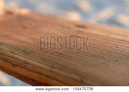 Wooden teeter on the beach, close up