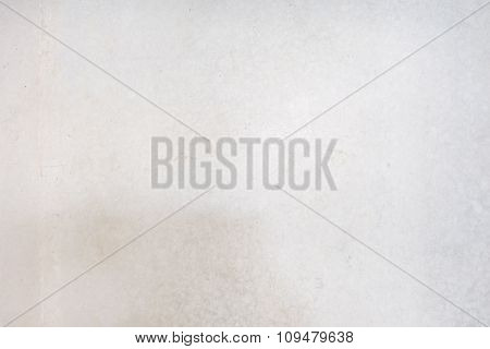 Grungy white concrete wall background. Background from high detailed fragment stone wall.