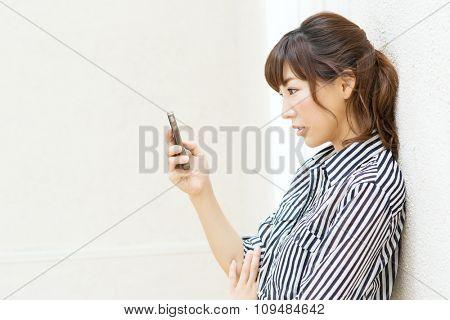 Beautiful asian woman using cellphone