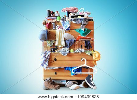 Mess, dresser with scattered clothes