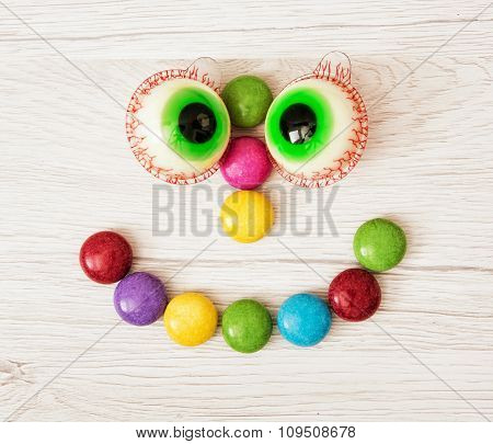 Smiling Face Of Smarties And Chewing Gums In The Form Of Eyes
