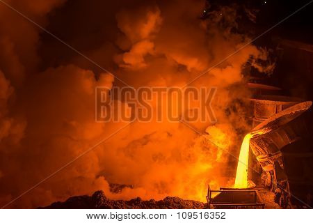 very hot steel pouring in steel plant poster