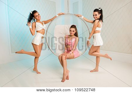 Three Sexy Cheerful Girls With Roand Chair