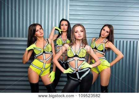 Four Sexy Girls In Stage Costumes
