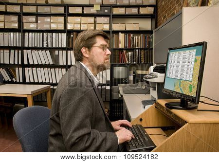 Researcher Searching A Computer Database Archive