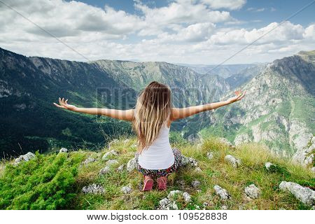 woman youga relax at the end of earth in fascinating landscape in Montenegro back view poster