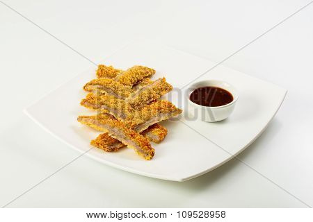 Sliced fish sticks and souce