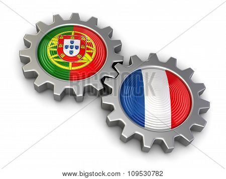 Portuguese and French flags on a gears (clipping path included)