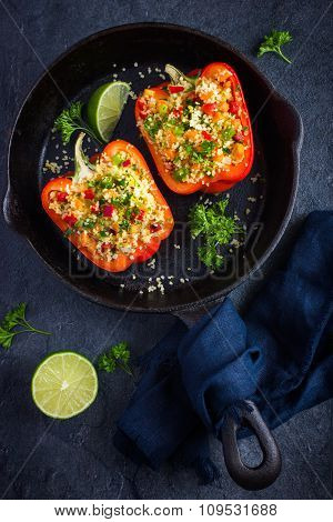 Peppers Staffed With Coucous And Vegetables On Cast Iron Pan