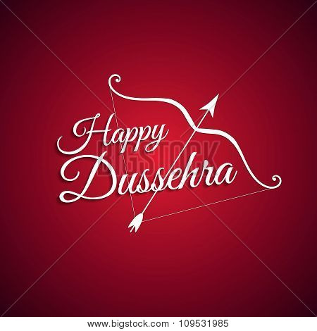 White text calligraphic inscription Happy Dussehra festival Indian with bow and arrow with a shadow