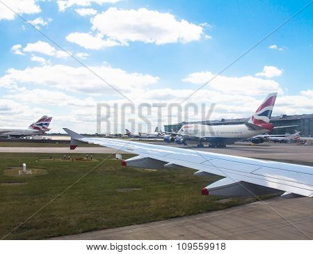 Taxiing Aircraft Airbus A-320  After Landing In Heathrow Airport . London. Uk