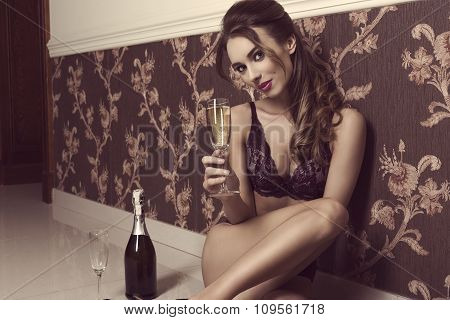 Woman In Lingerie And Champagne