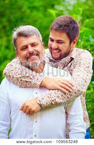 Portrait Of Happy Father And Son, Which Are Similar In Appearance