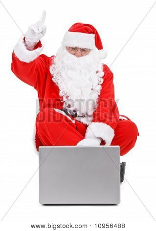 Surprised Santa Claus And Laptop On White