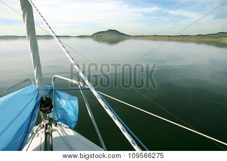 Prow View Of Sailboat Sailing Across Alange Reservoir, Spain