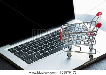 Mini Shopping Cart On Laptop : Online Shopping Concept