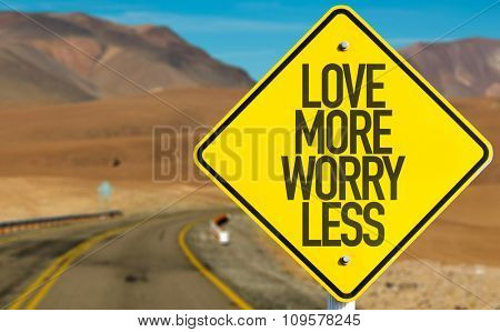 Love More Worry Less sign on desert road