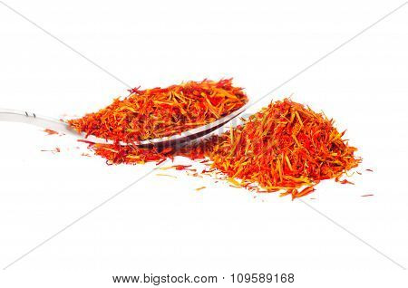 spoon with saffron petals on a white background next to a roller coaster of saffron
