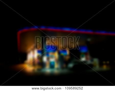 Blurred / Defocussed Abstract Background Of A Gas Station At Night