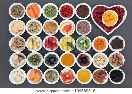 Cold cure and flu remedy food with health foods high in antioxidants and vitamin c with supplement capsules and medicinal herbs.